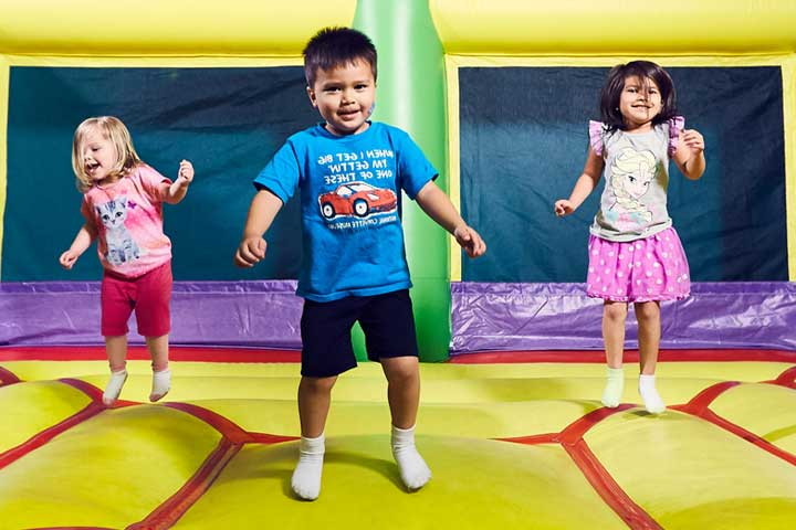 kids jumping in Bounce Inflatables