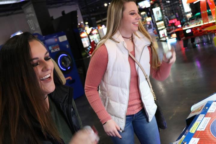 Girls Playing Arcade Games