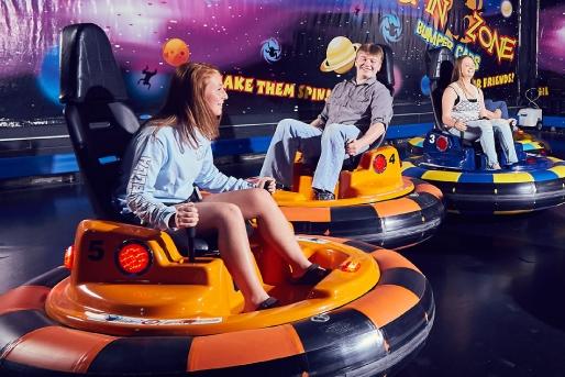 Teens Riding Bumper Cars
