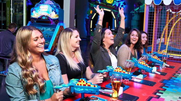 A group playing an arcade game